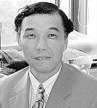 富山慶典 教授